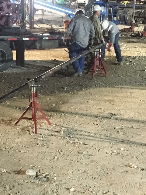 Working on a wireline downhole assembly