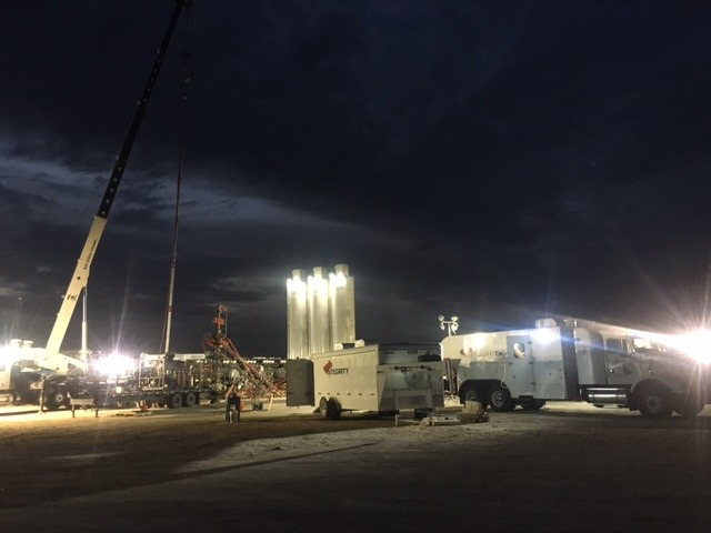 Integrity Wireline crew on location at night