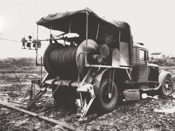 This old-time wireline truck has a belt running off the back wheel's hub